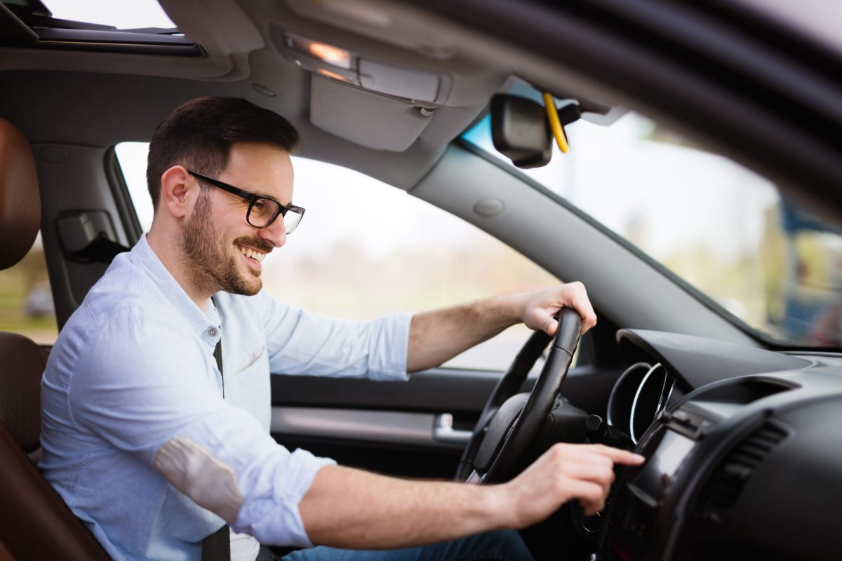 Man using modern navigation system while driving car